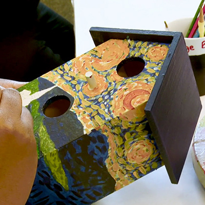 Painting a bird house to sell at craft store - Massachusetts Vocational