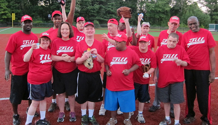 TILL Softball red shirts group photo of team