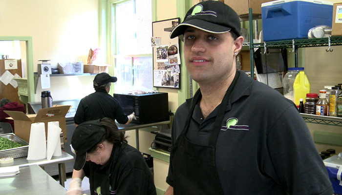 B Vocational ETC Food Service  Man smiling while in kitchen 700