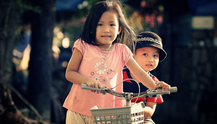siblings on bike