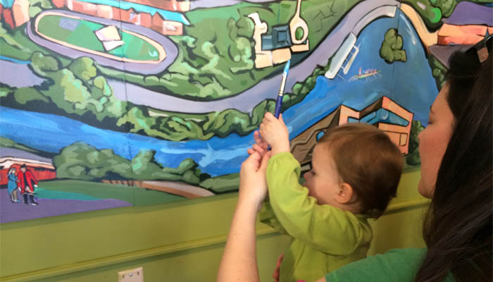 child painting mural