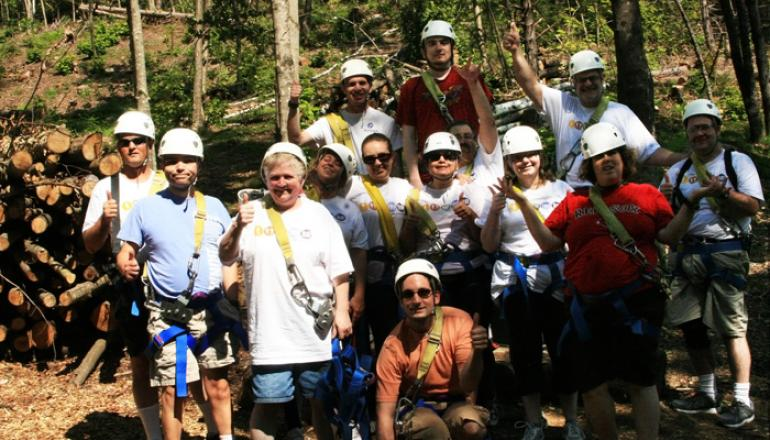 Group of adults ziplining